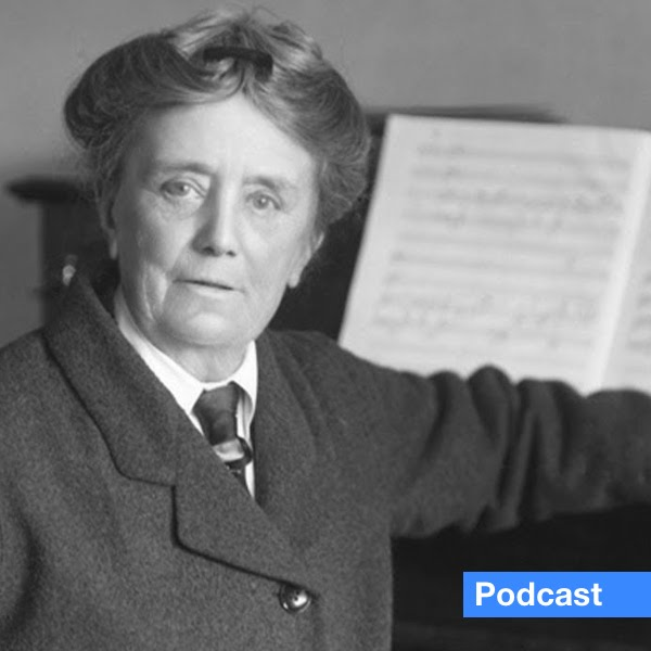 Composer Dame Ethel Smyth portrait sitting at her piano with music score open